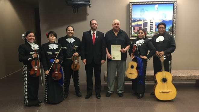 County Commissioner David Stout and Juan Gabriel's promoter Lazaro Megrete in the center accompanied by Mariachi Paso Del Norte.