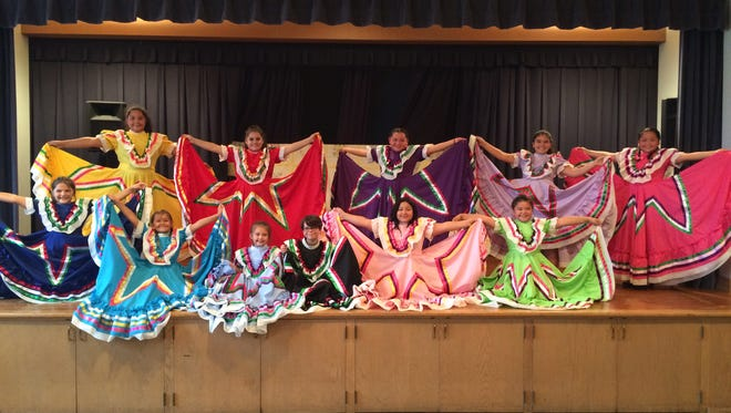 Members of the Mi Pueblo Ballet Folklorico group gathered last week to practice the traditional Mexican dance to prepare the the upcoming Mi Pueblo 2nd Anniversary celebration on Sept. 24 in Washington Park.