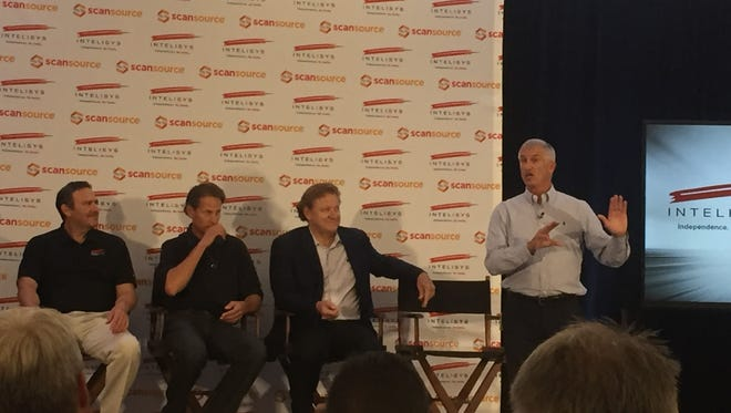 ScanSource CEO Mike Baur (far right) explains the story of how ScanSource acquired Intelisys at a Monday event.