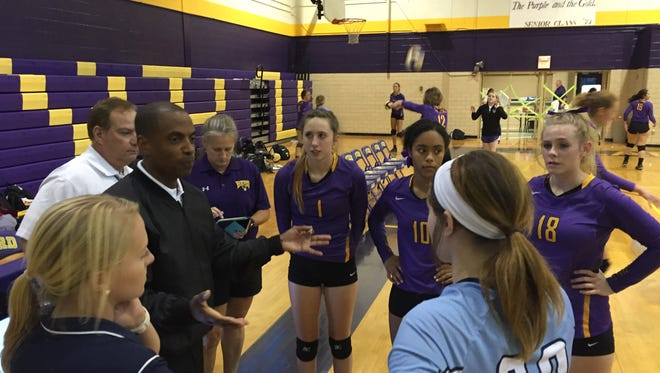 Volleyball offical Reiko Meeks meets with coaches and players from Byrd and Airline prior to Tuesday's game at Byrd.