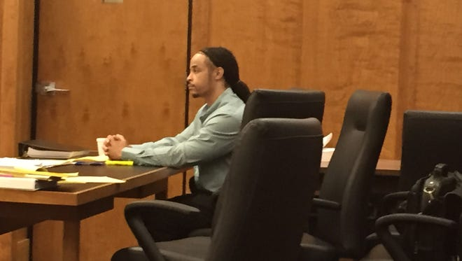 Darryl Taylor sits at the defense table on Tuesday, the fourth day of his trial.