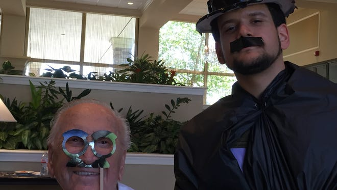 Staff member Ben Kieserman (right) and resident Harry Alberti (left) dress the part as they explore how film has changed from the days of Charlie Chaplin to today.