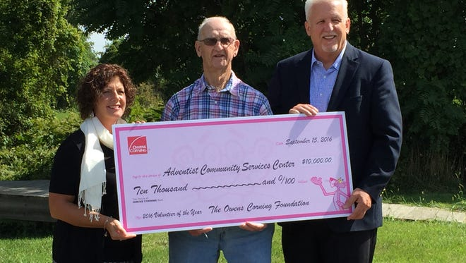 Jim Spitler (center) was named by Owens Corning as the retiree volunteer of the year. Also pictured are Owens Corning Community Relations Lead Ann Malak and Newark Seventh-day Adventist Community Church Pastor Tom Hughes.