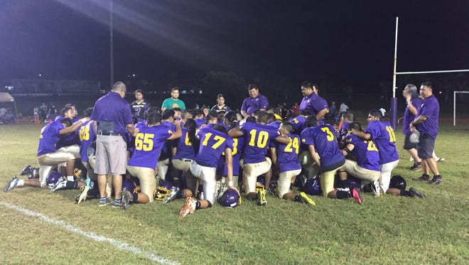 The GW Geckos huddle on the field after their 33-0 shutout win over the Sanchez Sharks in an IFL game Friday night.
