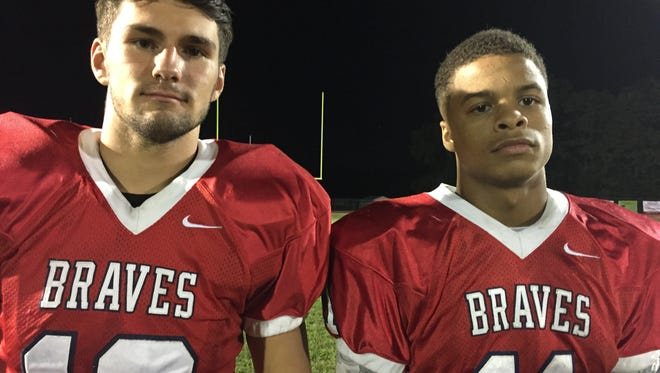 Luke Corcione (left) and Naim Mayfield led Manalapan to victory.