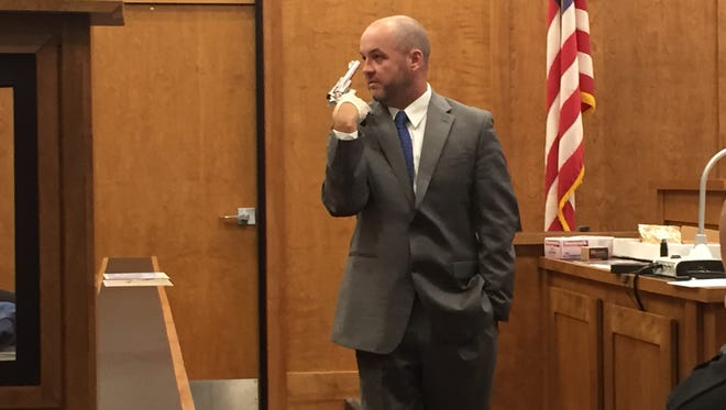 Richland County Assistant Prosecutor Brandon Pigg holds the .44 Magnum that Darryl Taylor used to kill Deborah Hovestadt.
