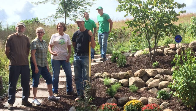 This summer, the McCulloughs met with Myers and representatives from Stuart's Landscaping and Garden Center of Fond du Lac to discuss best practices and Grow Smart compatible plantings for their yard. The McCulloughs chose to landscape an area close to their house that is common to many homes: a steep incline with an exposed, walkout basement. But they also wanted to make sure the landscaping was complementary to other areas on their property.