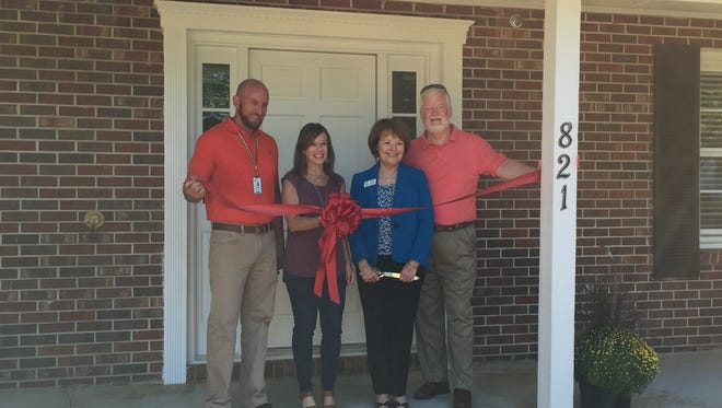 Generations Group Executive Director Brian Clark, left to right, Pathways Board member Kimberly Haynes, Generations Founder and CEO Kathleen Reynolds, and Pathways Board member Billy Crank prepare to cut the ribbon for the reopening of the Hartwell House on the Generations campus in Fountain Inn Tuesday.