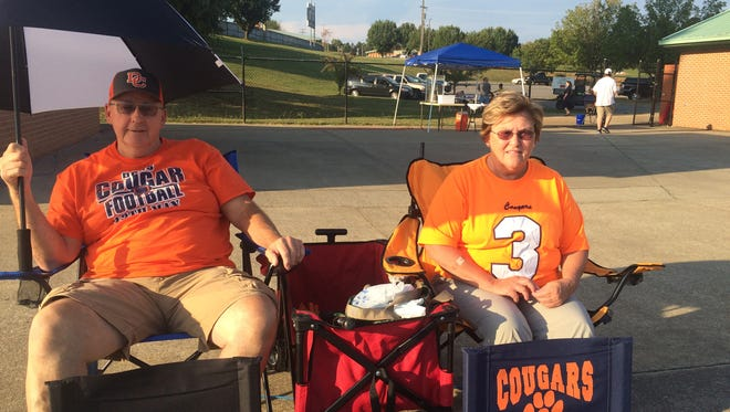 From left, John and Carrie Murphree have been sitting in the same spot for 15 years at Dickson County games.