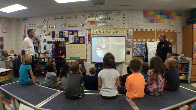 Sherry Marzofka's kindergarten class at Howe School watches a new video about fire safety given to them by the Wisconsin Rapids Fire Department with community donations.