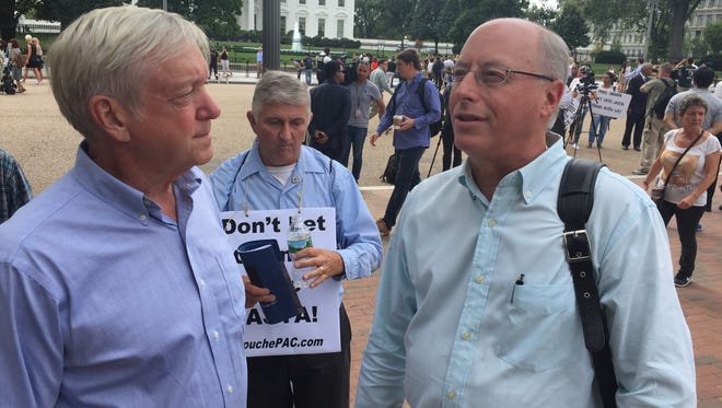 David Ziminski of Tarrytown (right) and William Dietrich of Peapeck, N.J.joined in a demonstration outside the White House on Tuesday urging President Obama to act quickly to either sign or veto legislation that would allows 9/11 families to sue Saudi Arabia in connection with the 2001 terrorist attacks. Both men lost their wives on 9/11.