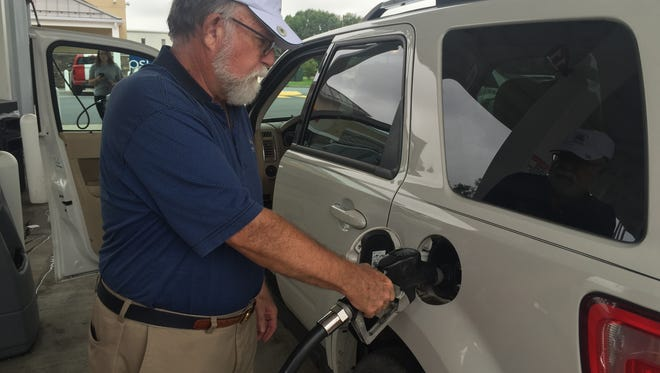 Jim Moore of Brandywine Hundred fills up his Ford Explorer at a Wawa convenience store near New Castle on Sept. 20. Gas prices in Delaware have spiked in recent days after a pipeline spill in Alabama.