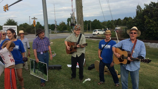 "Atlantic Coast Pipeline protestors sing ""We don't want your pipeline,"" led by folk singers Robin Williams (far right) and Linda Williams (not pictured) at a rally outside the Dominion Energy offices in Staunton, Virginia, on September 21, 2016."