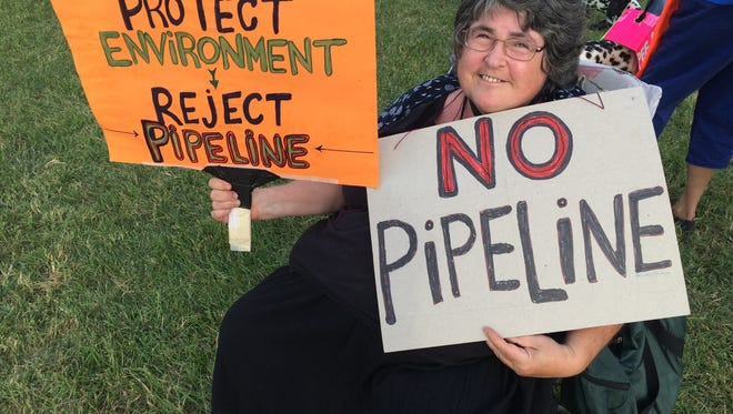 Nita Witting, a Staunton resident, protests the proposed Atlantic Coast Pipeline at a rally outside the Dominion Energy offices in Staunton, Virginia, on September 21, 2016.