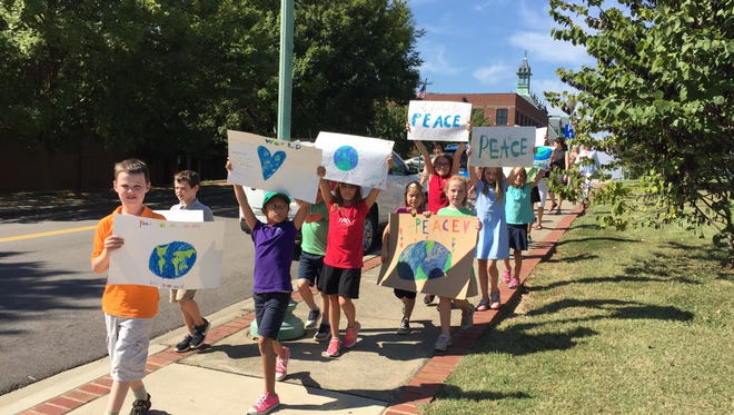 Amare Montessori students rally for peace in Downtown Clarksville on the occasion of International Day of Peace.