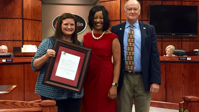 Bethel Elementary teacher Katie Saunders, left to right, Bethel principal Nerissa Lewis and Mauldin Mayor Dennis Raines.