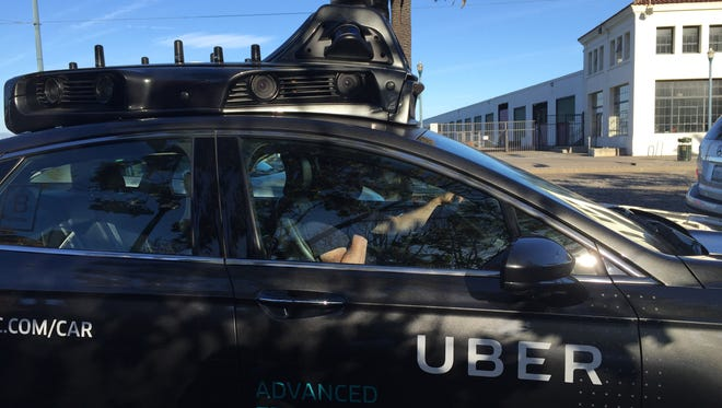 An Uber self-driving car logs some miles on the streets of San Francisco.