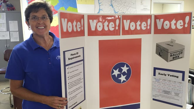 Stewart County Administrator of Elections Nellie Anderson shows a display she and Houston County Administrator of Elections Annette Pulley will use for voter registration drives in both counties.