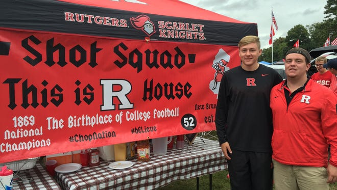 James Surico and Mike Keelen (far left) are the top officers of the Rutgers Riot Squad. They hosted a scaled-down tailgate Saturday before the Iowa game.