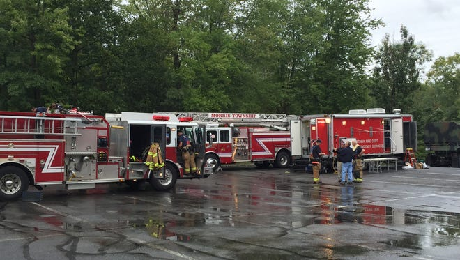 Fire departments and hazardous materials specialists mop up after a chemical decontamination raining drill at Streeter Pool in Morris Township on Sept. 24, 2016.