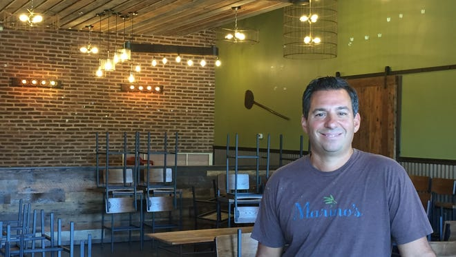 Anthony Marino stands in his expanded Marino's of Mullica Hill pizzeria and cafe.