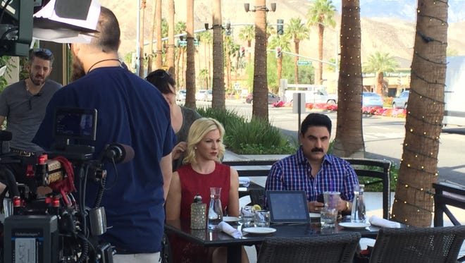 """Reza Farahan on right and Taylor Spellman on left film an episode of Bravo TVs """"Yours, Mine or Ours,"""" at The Daily Grill in Palm Desert.  The new show premieres Oct. 3 and  features Krystle Kelley of Palm Desert and her boyfriend Christopher Baskin of Los Angeles in an episode."""