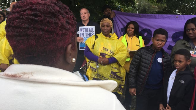 Charnette Grayson, foreground, sister of the late Latasha Shaw, addresses those gathered during an anti-violence rally and vigil for Shaw on Thursday.