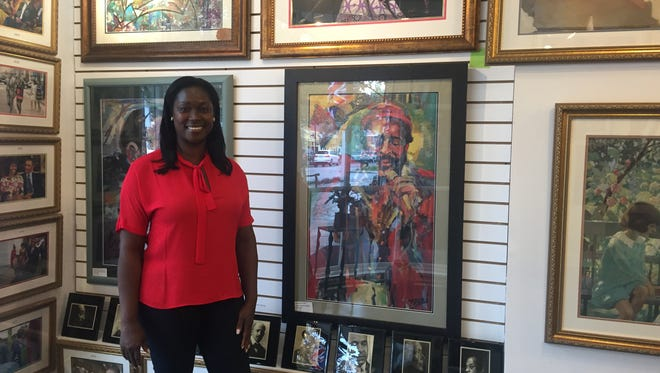 Mame Young shows some of the works offered at LaBelle Art Gallery, opening Oct. 22.