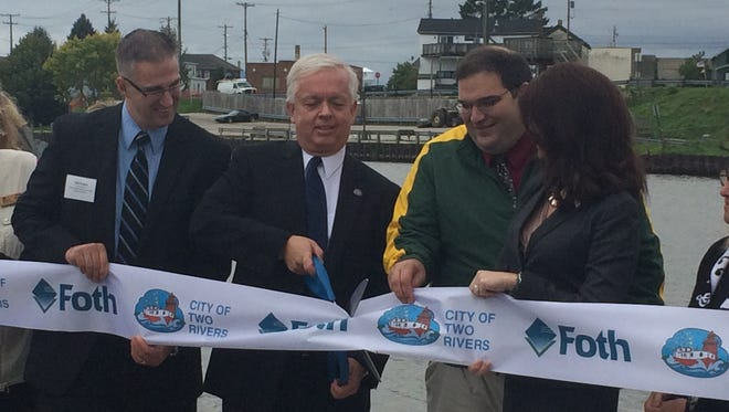From left: Rob Kovak, policy advisor for State Sen. Frank Lasee, City Manager Greg Buckley, State Rep. Andre Jacque and Lt. Gov. Rebecca Kleefisch participate in the ribbon cutting for Harbor Park in Two Rivers.