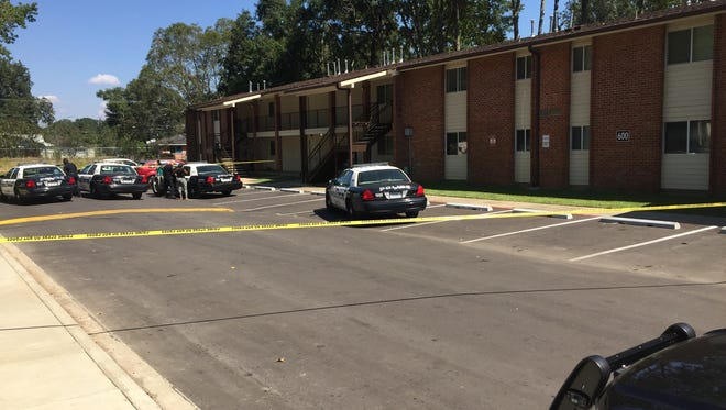 Lafayette police respond to a shooting at Holy Family Apartments in Lafayette Monday.