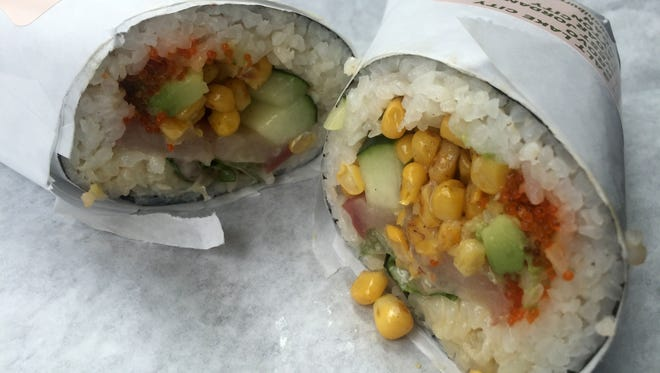The Hamachi Wrap from Sushi Burrito #5 in Cedar City features yellowtail, tobiko, avocado, cucumber, lettuce, corn, wasabi mayo and eel sauce.