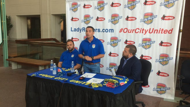 New Lady Rafters FC coach Ryan McConville speaks to the media with Rafters coach Greg Palmer (left) and president Will Broyles (right) looking on at Regions Tower Tuesday afternoon.