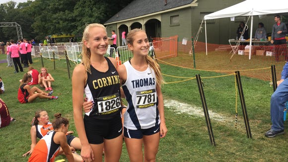 Corning's Jessica Lawson and Webster Thomas' Amanda Vestri at the 2016 McQuaid Invitational. The seniors finished one-two in the girls seeded large schools race.