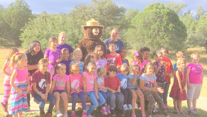 The Girl Scouts of the Desert Southwest held a picnic recently and got a chance to meet Smokey the Bear.