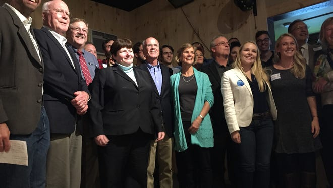 Democratic gubernatorial candidate Sue Minter, center, poses with other Democratic candidates and officials at a party Tuesday in South Burlington.