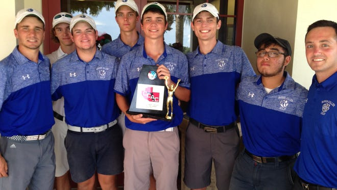 The Barron Collier High School boys golf team poses with the Collier County Athletic Conference trophy after winning the title Wednesday, Oct. 5, 2016 at Hibiscus Golf Club. Medalist Sam Nunner, who shot a 69, is holding the trophy.