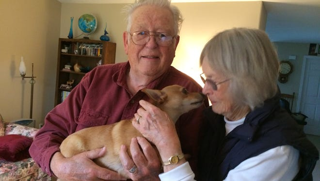 Arlan and Dorothy Blodgett with their dog, Henry, at their home in Sublimity.