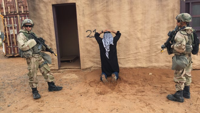 Soldiers from 1st Brigade recently went through the Iron Focus exercise at Fort Bliss. Here, soldiers detain a role player portraying an insurgent.