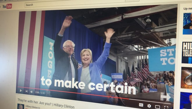 A screenshot of Clinton campaign Youtube channel shows a scene from a Sept. 29 ad featuring Sen. Bernie Sanders, I-Vt., along with a host of Democratic heavyweights including President Barack Obama.