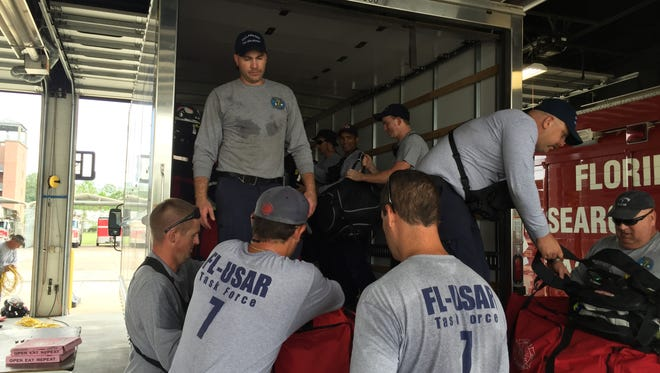 The Tallahassee Fire Department's Urban Search and Rescue Team packs a supply truck before traveling to Lake City on Thursday. The group will help assistant areas affected by Hurricane Matthew.