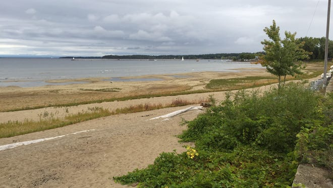 The low water lever on Lake Champlain has exposed a wide swath of sand on Sunday, Oct. 2, 2016, near Blodgett Beach off of the Burlington Bike Path in Burlington.