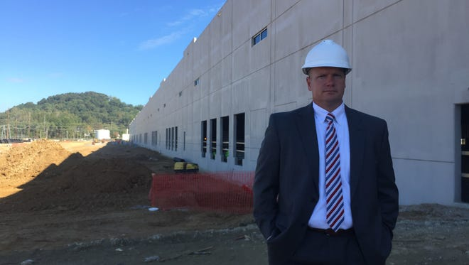Larry Lapinski, a vice president at NorthPoint Development, stands in front of a 750,000 square foot logistics center at a former Harley-Davidson manufacturing site on Eden Road within the greater Harley-Davidson complex.