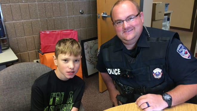 Sunrise fourth-grade student Jack Larson meets with his big brother Derek Jennerjohn, a Sturgeon Bay Police officer. Jennerjohn is taking part in the Big Brothers Big Sisters' Bigs in Blue program.
