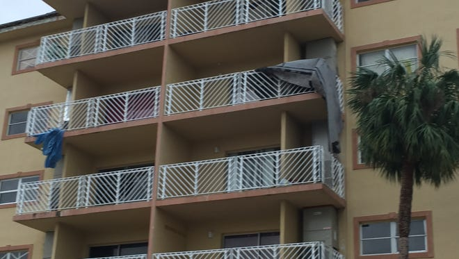 Chunks of the roof at Bay Towers were seen hanging from balconies at the complex on U.S. 1 in Titusville.