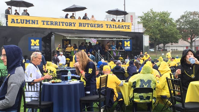 Michigan football fans threw a vast pre-game party at High Point Solutions Stadium.