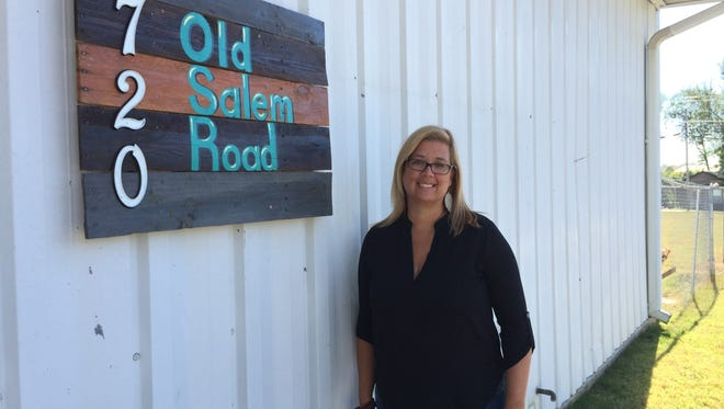 Ginger Scott, board member of Stepping Stones Safe Haven Inc., stands in front of the new day shelter for the homeless women's program, located at 720 Old Salem Road in Murfreesboro.