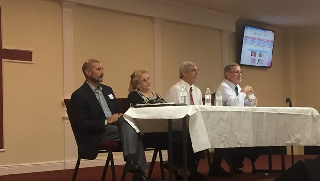 Superintendent candidates fielded questions from the Southside community at Bible Based Church Monday night.