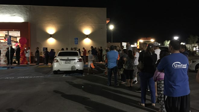 The line at the grand opening for Dunkin' Donuts in Indio Tuesday stretched into the parking lot.
