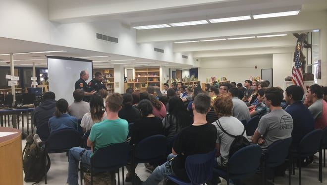 Members of the Carlsbad Police Department discuss training in the department during a presentation for high school seniors.
