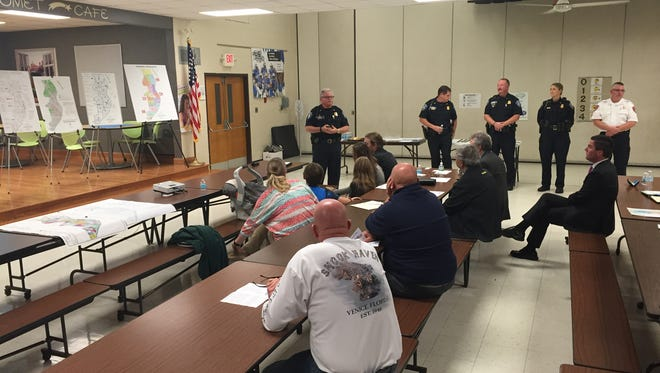 Director of Public Safety Michael Reaves gives residents in the northern quarter of Port Huron a rundown on his department's activities during the first of four planned neighborhood briefings on Wednesday, Oct. 12, 2016, at Crull Elementary School.
